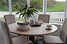 Neptune Chichester Pedestal Oak Table + Chairs